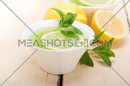 fresh and healthy mint infusion tea tisane with lemon