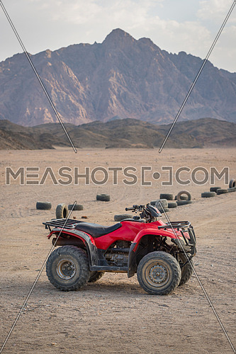 ATV Quad Bike in the desert and background beautiful  stone mountain.