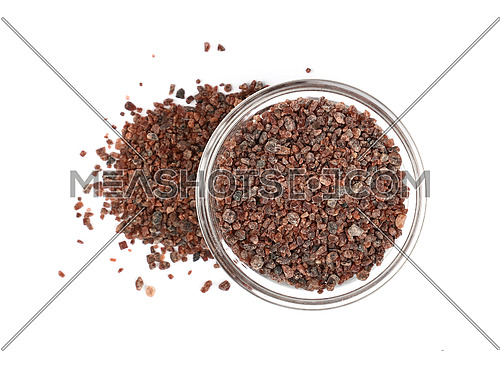 Close up one glass bowl saltcellar full of crystals Indian brown Kala Namak salt isolated on white background, elevated top view, directly above