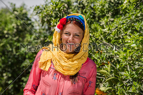 a portrait of an egyptian female farmer wearing traditional clothes