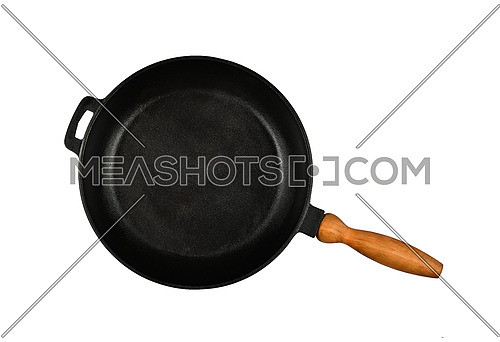 Close up one empty black cast iron frying pan with wooden handle isolated on white background, elevated top view, directly above