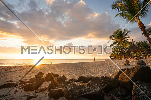 Mother and daughter on the beach at sunset, Flic en flac beach, mauritius island