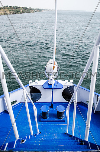 A front deck of a boat in navy blue