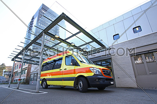 Emergency room entrance at a general hospital with ambulance parked in front of it
