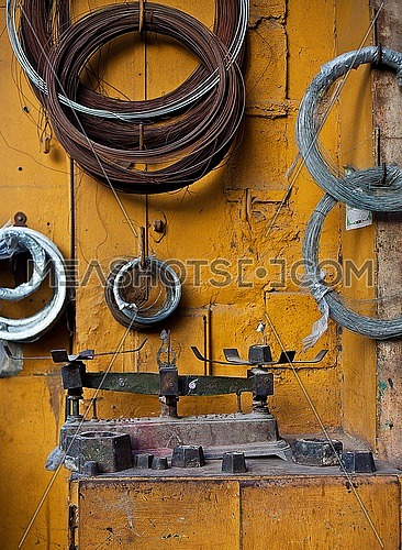 an old weighing scale in a workshop placed against an orange brick wall