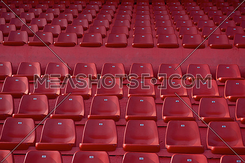red stadium seat row wallpaper chairs empty