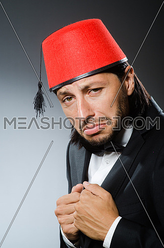 Man in traditional turkish hat and dress
