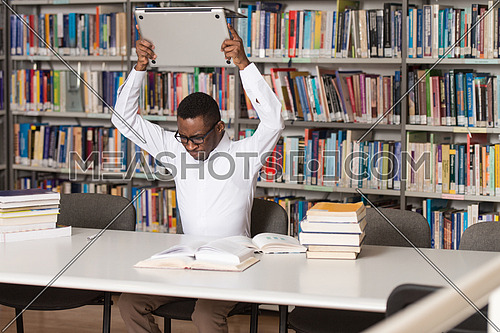 African Male Student Throwing Laptop And Want To Destroy It - Shallow Depth Of Field
