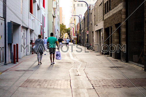 people passing by in a side street