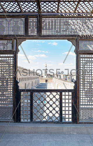 Passage surrounding the Mosque of Ibn Tulun framed by interleaved wooden perforated wall (Mashrabiya), Medieval Cairo, Egypt