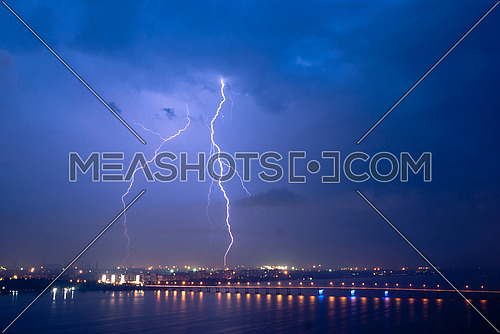 View of a lightning over city at night