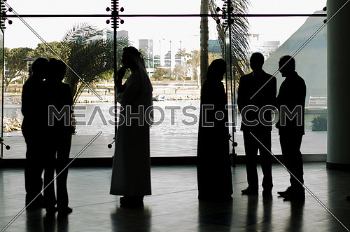 group of people standing in a business meeting