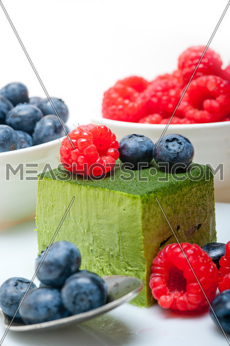 green tea matcha mousse cake with raspberries and blueberries on top
