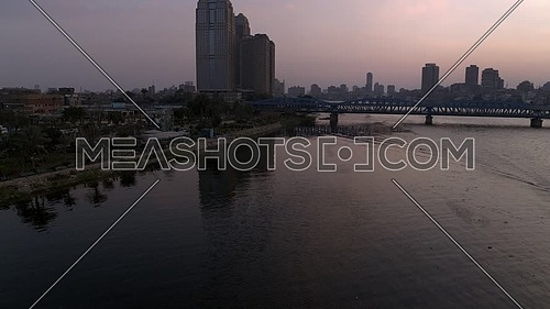 Fly Over Rod El Farag Area showing Imbaba Bridge, The River Nile and Nile Towers in Cairo - 19 January 2019 - by the Sunset.