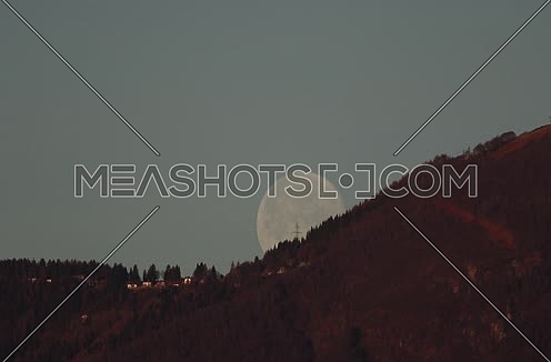 Moon setting behind a mountain timelapse