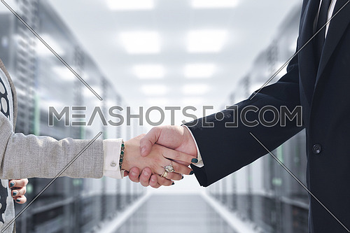 business man and woman handshake on successful  meeting at rack server room