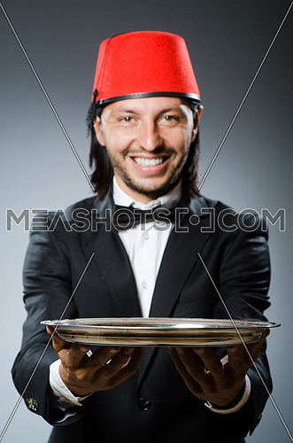 Waiter wearing traditional turkish hat