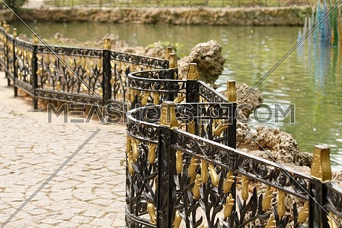 A fence in Emirgan Park that separates the pond from pathway. Istanbul, Turkey