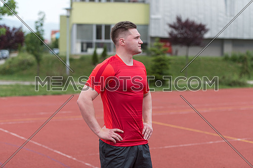 Young Man In Sports Clothing After Outdoor Exercises