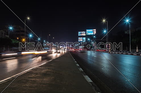 Zoom IN Shot for traffic at Salah Salim Street both sides at Night