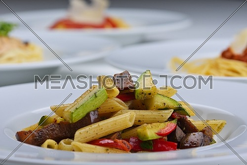 Pasta with shrimps, herbs and mashrooms isolated on white background in studio