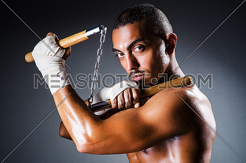 Strong man with nunchaku