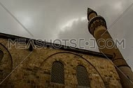 A time laps shot of a Mosque minaret in Bursa, Turkey showing clouds
