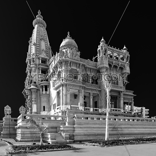 Black and white Angle view of rear facade of Baron Empain Palace, a historic mansion inspired by the Cambodian Hindu temple of Angkor Wat, located in Heliopolis district, Cairo, Egypt