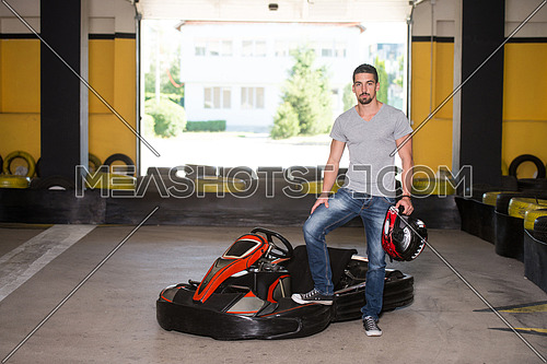 Young Man Is Driving Go-Kart Car With Speed In A Playground Racing Track - Go Kart Is A Popular Leisure Motor Sports