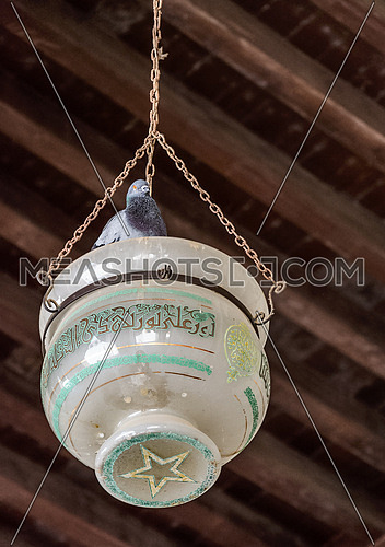 ELHakem Mosque glass lamp hanging from the wooden ceiling