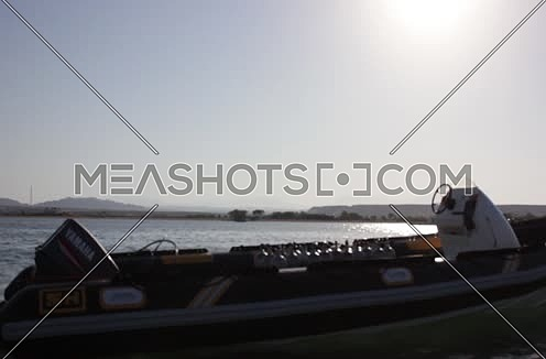 Long shot for a motorboat unmoved in the Red Sea at Wadi Lahmi at day - 5D
