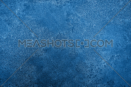 Grunge dark blue uneven stone texture background with cracks and stains