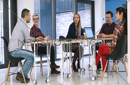 Business people having a meeting in modern office building