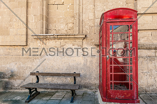Traditional red phone boot and wooden bench