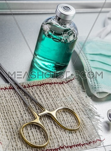 Instrumental surgical in operating room, Scissors and vial, conceptual image