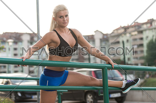Beautiful Woman Portrat Outdoors Doing Streching Exercises