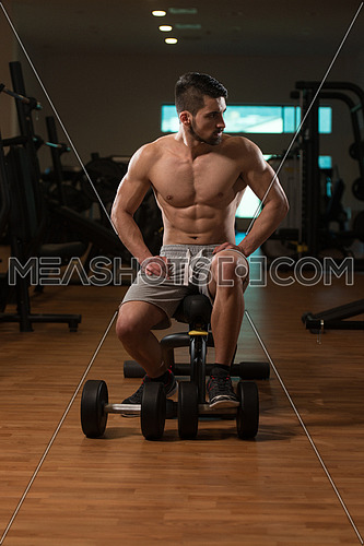Resting Time - Confident Muscled Young Man Resting In Healthy Club Gym After Exercising
