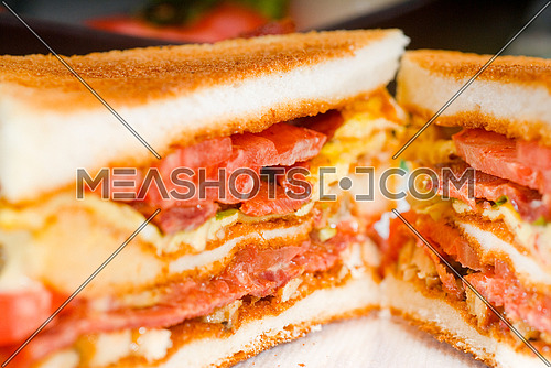 fresh and delicious classic club sandwich over a transparent glass dish
