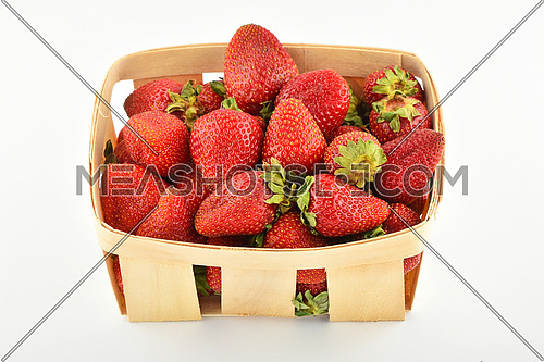 Mellow fresh summer strawberries in wooden basket isolated on white background