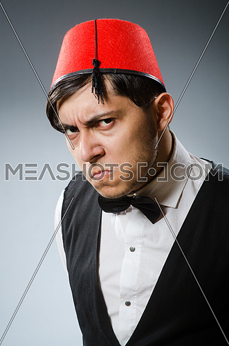 Man wearing traditional turkish hat fez