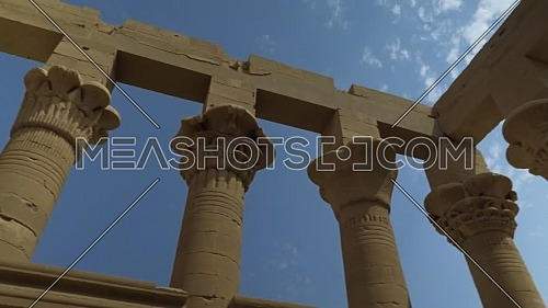 Low angel orbit shot inside Temple of Phila showing columns, Aswan Egypt