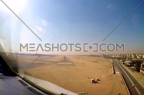 Cockpit view for a air plane landing at Egypt Cairo International Airport