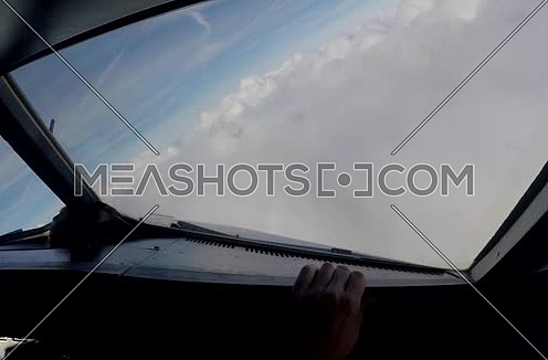 inside cockpit shot for plane flying through clouds