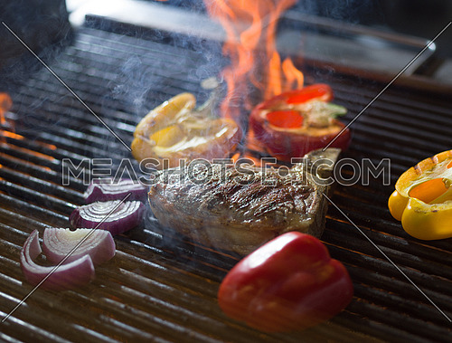 delicious grilled meat steak with vegetables on a barbecue