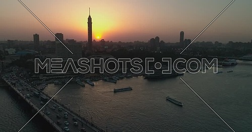 Aerial shot for the Cairo Tower and The River Nile showing Novotel Hotel and Kasr Al Nile bridge in Cairo,  Egypt at dusk