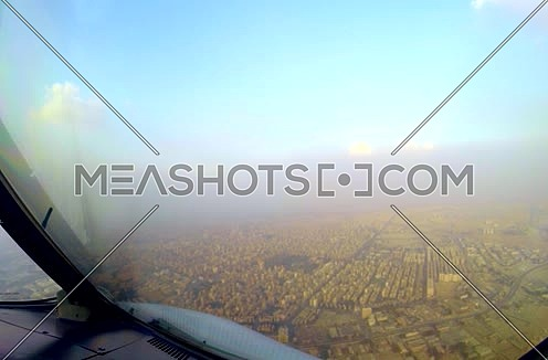 Cockpit view for a air plane flying over  Egypt Cairo city