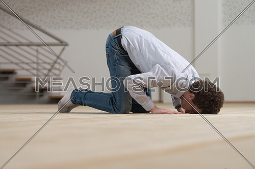 Humble White Muslim Man Is Praying In The Mosque - Afro Lock Hair Curly