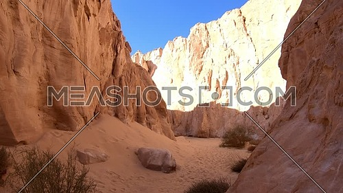 Follow shot explore inside White Canyon in Sinai at day