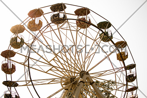 An abandond ferris wheel in a park