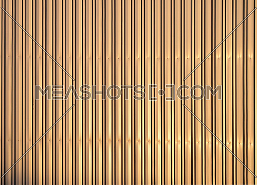 Golden colored aluminum corrugated goffered metal wall texture background